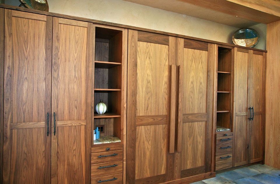 Murphy bed with custom walnut cabinets, Sea Ranch bluff-top residence