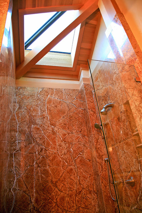 Shower in a Brazilian rainforest granite with skylight, Sea Ranch bluff-top residence